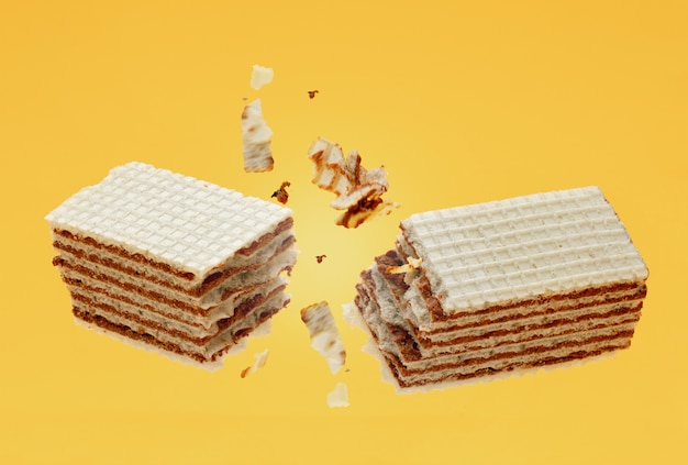 Chocolade knettert knapperige wafeltjes met kruimels op geel Premium Foto