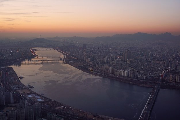 Cityscape van seoel zonsondergang, han-rivier Premium Foto