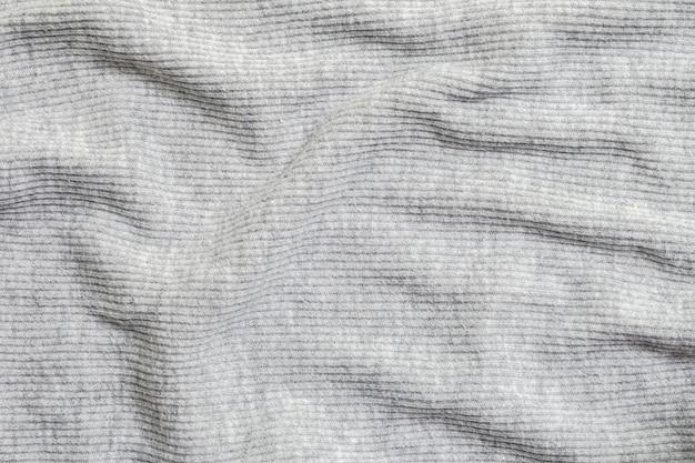 Close-up abstract patroon bij gerimpelde de kledings geweven achtergrond van grijze vrouwen Premium Foto