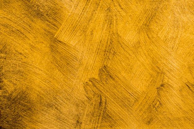 Close-up abstracte gouden geschilderde achtergrond Premium Foto