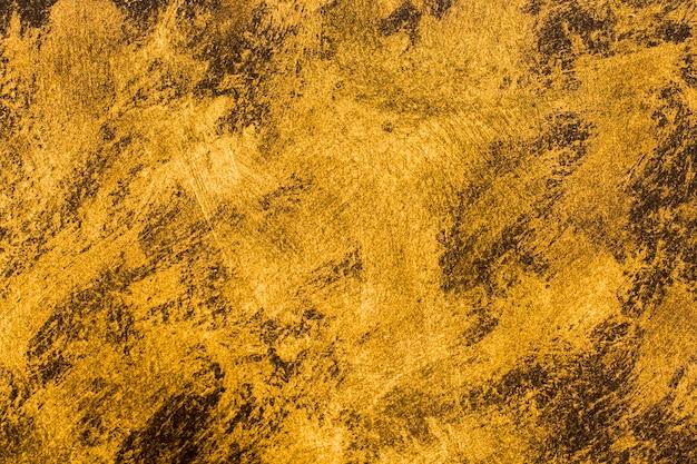 Close-up gouden geschilderde achtergrond Gratis Foto