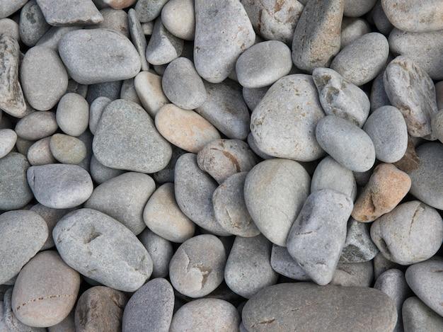 Close-up shot van de gemengde stenen van de strandkiezelsteen Gratis Foto