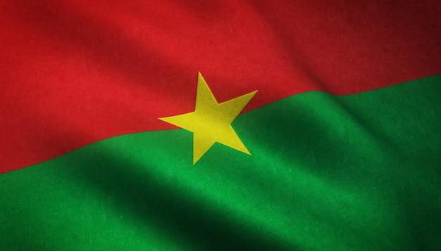 Close-up shot van de vlag van burkina faso met grungy texturen Gratis Foto
