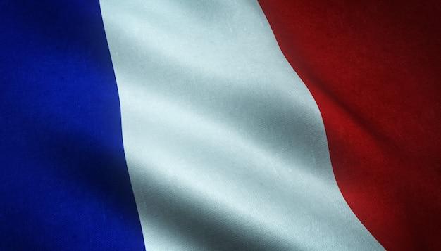 Close-up shot van de wapperende vlag van frankrijk met interessante texturen Gratis Foto