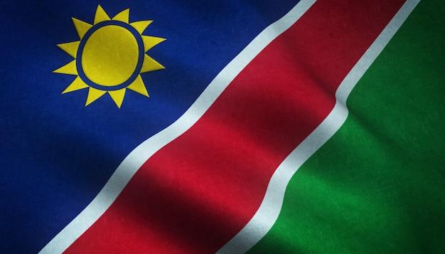 Close-up shot van de wapperende vlag van namibië met interessante texturen Gratis Foto