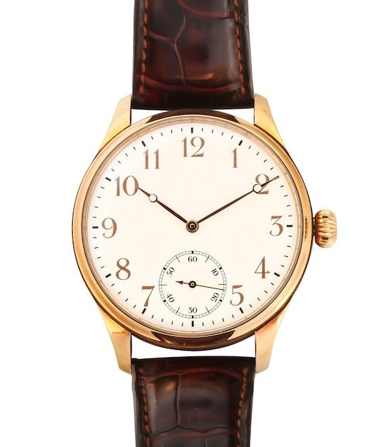 Close-up shot van een gouden horloge geïsoleerd Gratis Foto