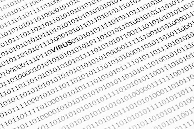 Close-up shot van een wit oppervlak met virus en enen en nullen erop Gratis Foto