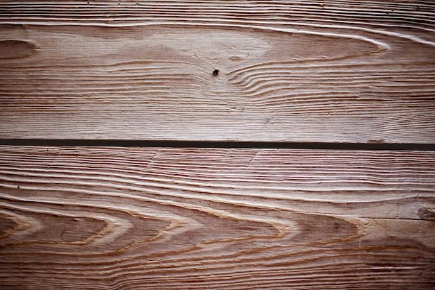 Close-up shot van muur gemaakt van horizontale bruine houten planken - perfect voor cool behang Gratis Foto