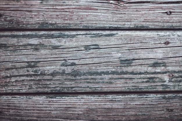 Close-up shot van verweerd hout - achtergrond Gratis Foto