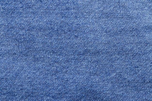 Close-up van blauwe denim jeans achtergrondstructuur Premium Foto