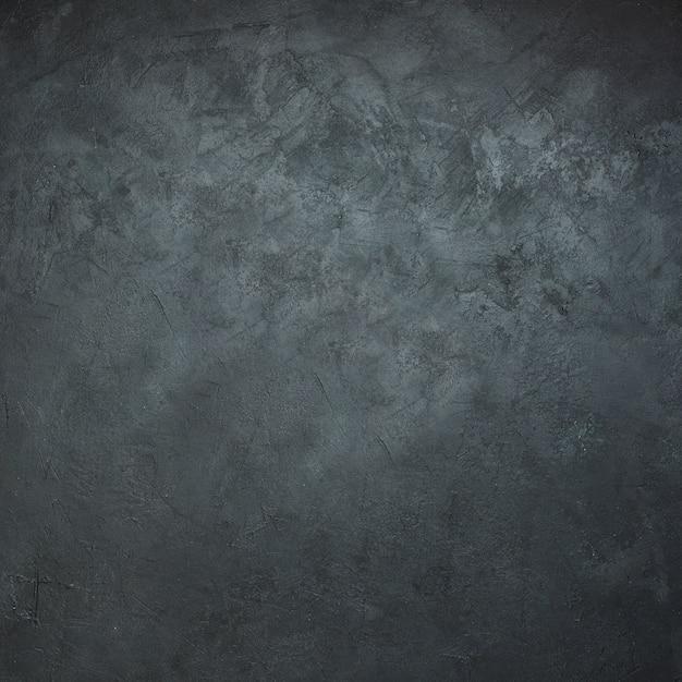 Close-up van de donkere zwarte achtergrond van de leisteen Gratis Foto