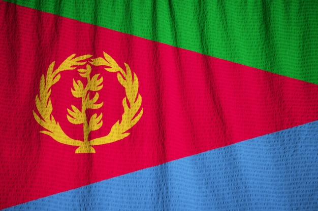 Close-up van de ruches eritrea vlag, eritrea vlag waait in de wind Premium Foto