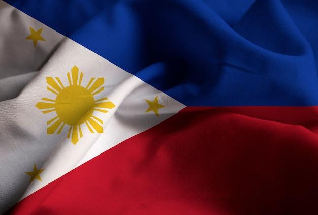 Close-up van de ruffled vlag van filippijnen, filippijnen vlag waait in de wind Premium Foto