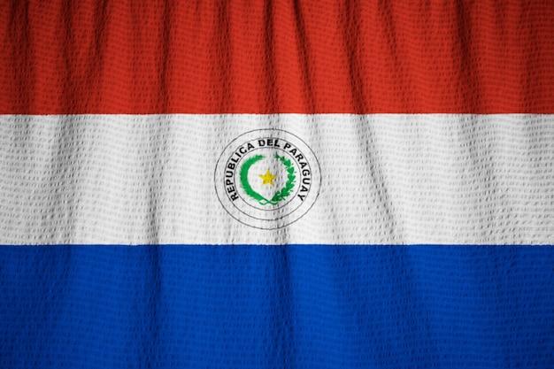 Close-up van de ruige paraguay vlag, paraguay vlag waait in de wind Premium Foto