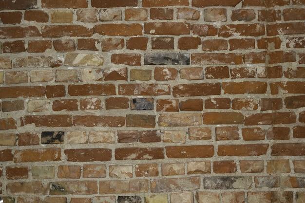 Close-up van een rode stenen muur achtergrond Gratis Foto