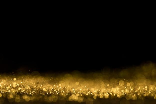 Close-up van gouden glitter met kopie ruimte Gratis Foto