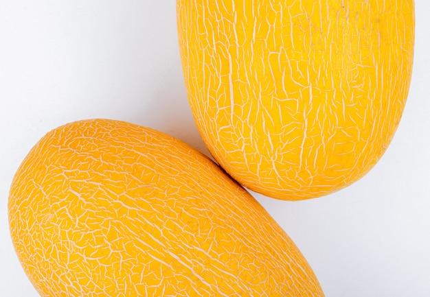 Close-up van meloenen op witte achtergrond Gratis Foto