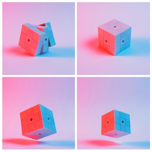 Close-up van puzzelblokjes tegen roze achtergrond met schaduw Gratis Foto