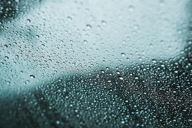 Close-up van regendruppels op een raam Gratis Foto