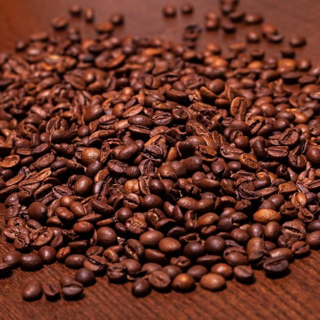 Close-upbeeld van geroosterde koffiebonen Gratis Foto