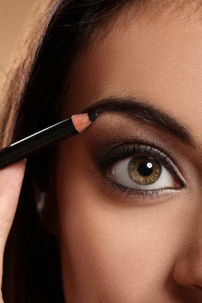 Close-upbeeld van het oog van de vrouw Gratis Foto