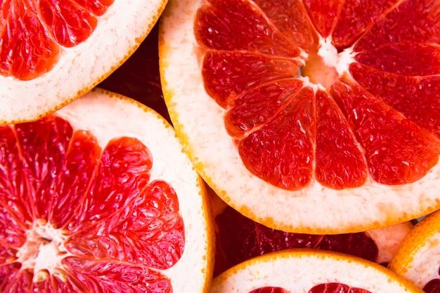 Close-upplakken van grapefruitachtergrond Gratis Foto