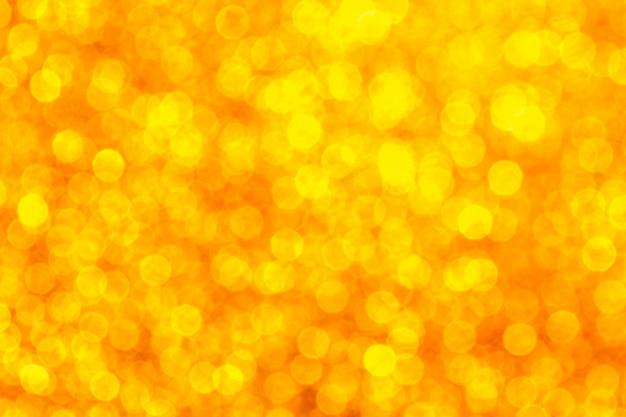 Creatieve kerstmis schittert gouden kleurenachtergrond Premium Foto