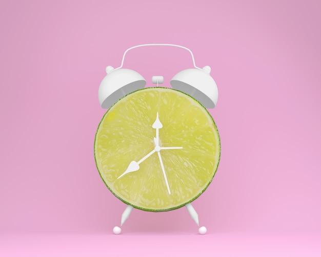 Creatieve van de de kalkplak van de ideelay-out wekker op pastelkleur roze achtergrond. minimaal fruit Premium Foto