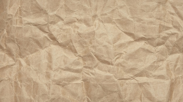Crinkle verfrommelde kraftpapier-achtergrond met geweven Premium Foto
