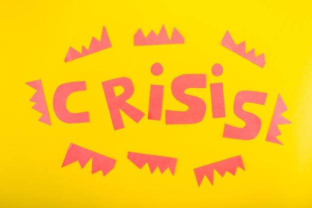 Crisis belettering van papier Gratis Foto