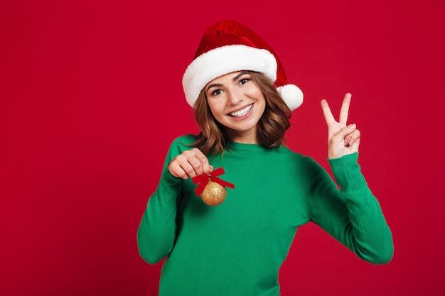 Dame die kerstmishoed draagt Gratis Foto