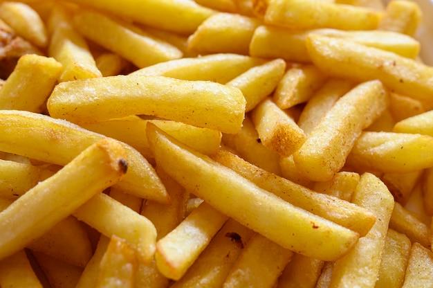 De aardappelfrieten sluiten omhoog. Premium Foto