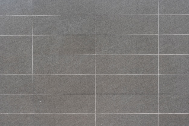De abstracte grijze achtergrond van de granietmuur Gratis Foto