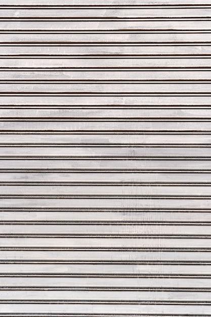 De abstracte witte muur van het strepenstaal Gratis Foto