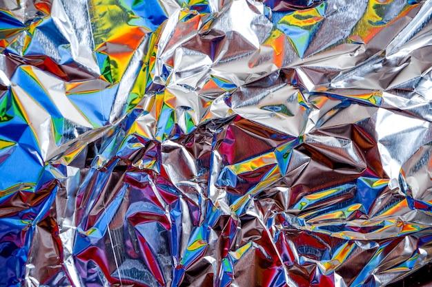 De aluminiumfolie van de regenboog verfrommelde zilveren textuur abstracte achtergrond Premium Foto