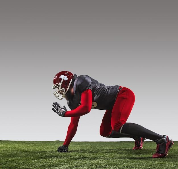 De american football-speler in actie Gratis Foto