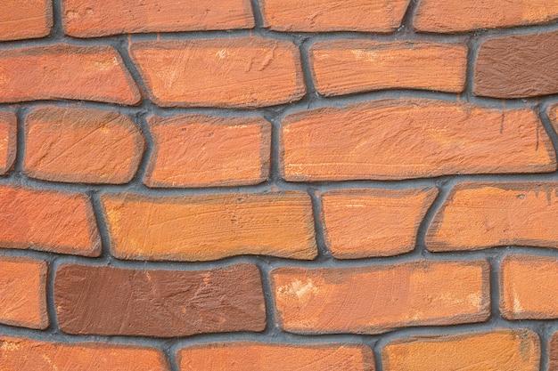 De baksteenpatroon van de close-upoppervlakte bij mooie bakstenen muur geweven achtergrond Premium Foto