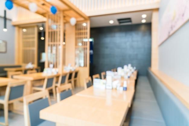 De binnenlandse achtergrond van het onduidelijk beeldrestaurant Gratis Foto