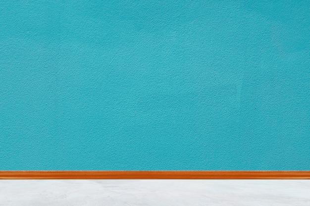 De blauwe concrete geschilderde achtergrond van de muurtextuur voor de muur van het ontwerphuis Premium Foto