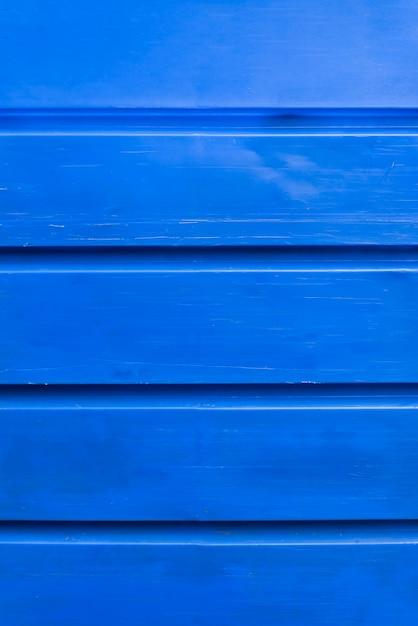 De blauwe houten achtergrond van de plankenmuur Gratis Foto