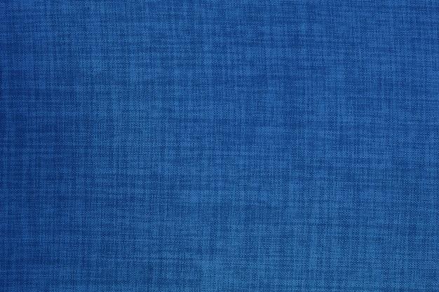 De donkerblauwe achtergrond van de de doektextuur van de linnenstof. Premium Foto