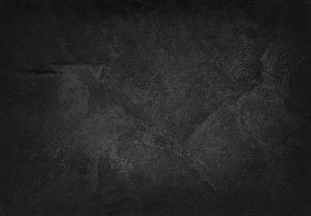 De donkergrijze zwarte achtergrond van de leitextuur Premium Foto