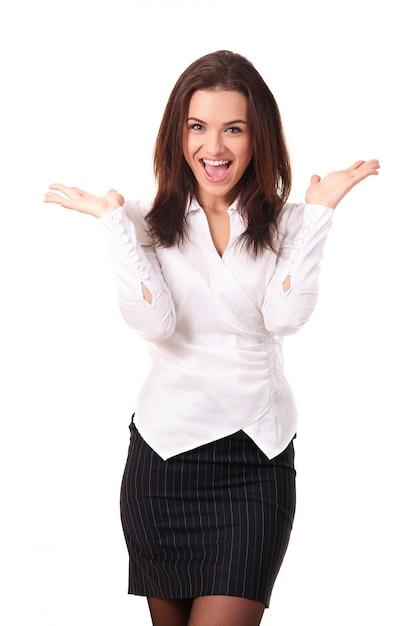 De gelukkige kaukasische onderneemster met handen hief het vieren van haar overwinning op wit wordt geïsoleerd op Premium Foto
