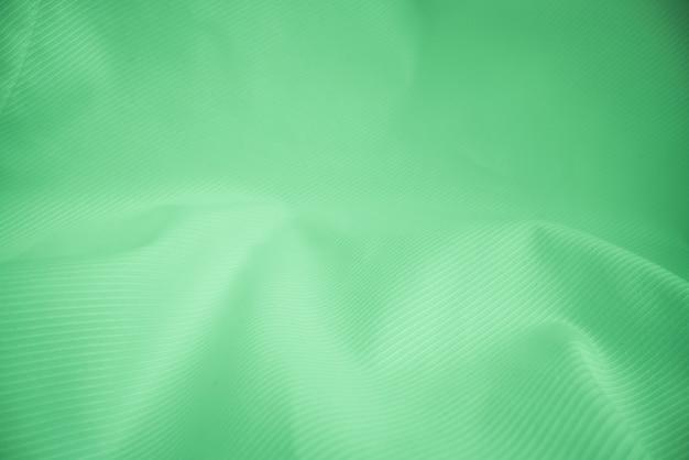 De glanzende stromende achtergrond van de doektextuur Premium Foto