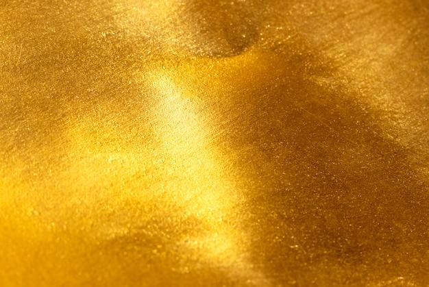 De glanzende textuur van de geel bladgoudfolie Premium Foto