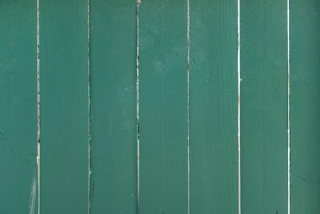 De groene houten achtergrond van de plankenmuur Gratis Foto