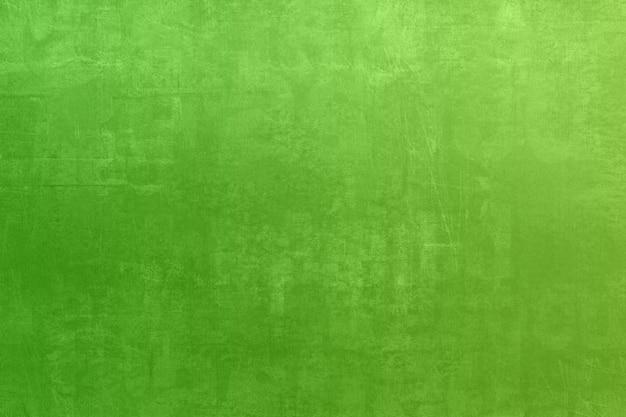De groene textuur van de grungevlek met de uitstekende retro filter van de gradiëntkleur voor achtergrond Premium Foto