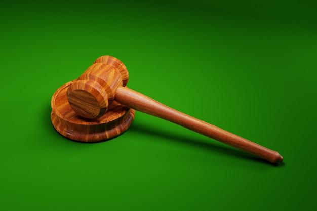 De hamer van de rechter op groene achtergrond; wet concept; 3d-afbeelding Premium Foto