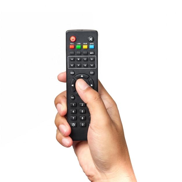 De hand houdt televisieafstandsbediening en drukt geïsoleerde knopen Premium Foto