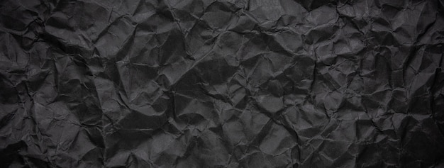 De haveloze verfrommelde donkere zwarte document textuurachtergrond Premium Foto